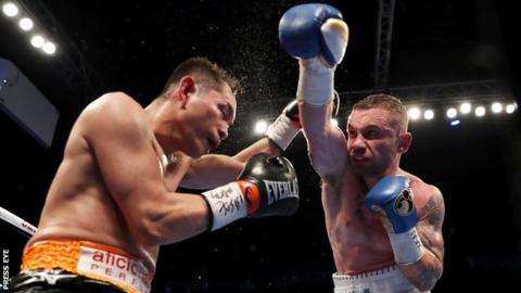Carl Frampton attempts to land a right hand on the Filipino