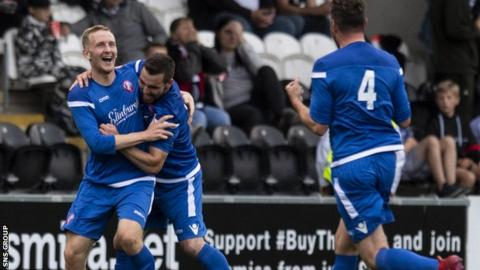 Scott Maxwell (left) celebrates making it 2-0 to Spartans in Paisley