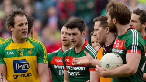 Donegal's Michael Murphy talks to Mayo's Aidan O'Shea after last year's Division One game