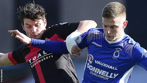 Philip Lowry of Crusaders in action against Dungannon's Dougie Wilson