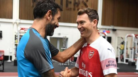 Stephan Lichtsteiner meets ex-Arsenal player Robert Pires at the club's training ground