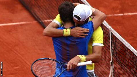Feliciano Lopez and Marc Lopez embrace
