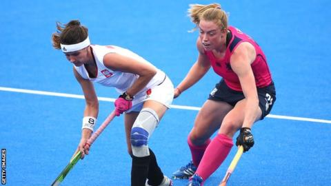 Joanna Wieloch of Poland holds off Alison Howie of Scotland during the EuroHockey Womens Pool C match