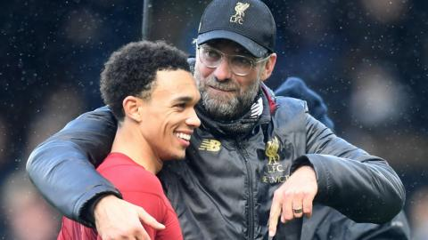 Liverpool boss Jurgen Klopp hugs a smiling Trent Alexander-Arnold after victory over Fulham