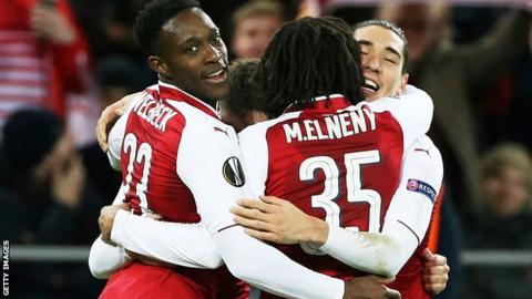 Danny Welbeck celebrates with his Arsenal team-mates
