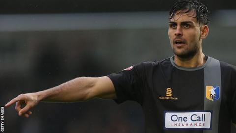 Ryan Tafazolli in action for Mansfield Town