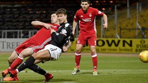 Aberdeen's Scott McKenna (left) deflects the ball into the net