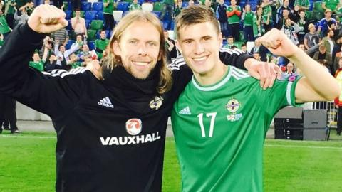 Austin Macphee celebrates with Northern Ireland's Paddy McNair