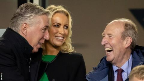 Shane Ross (right) shares a joke with John Delaney and his partner Emma English during the Republic of Ireland's game against Wales last October