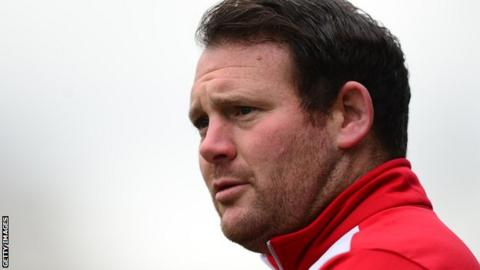 Darren Sarll watches on during his time as Stevenage boss