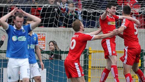 Cliftonville celebrate after Caoimhin Bonner headed them level at 2-2 against Premiership leaders Linfield at Solitude
