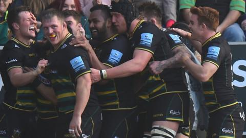 Northampton celebrate a try against Wasps