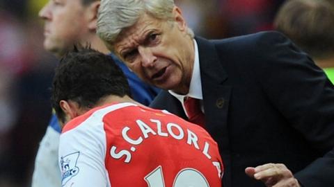 Arsene Wenger and Santi Cazorla