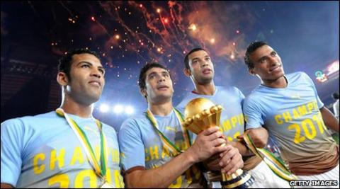 Egyptian players celebrate with the Nations Cup trophy in Luanda