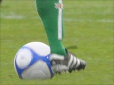Guernsey footballer's leg and football