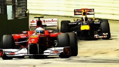 Ferrari driver Fernando Alonso with Red Bull's Sebastian Vettel just behind him at the Singapore Grand Prix