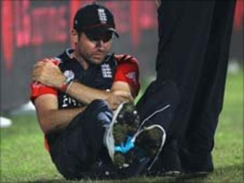 James Anderson holds his shoulder during the match against Bangladesh