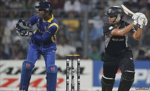 New Zealand's Ross Taylor plays a shot next to Sri Lanka's captain and wicketkeeper Kumar Sangakkara