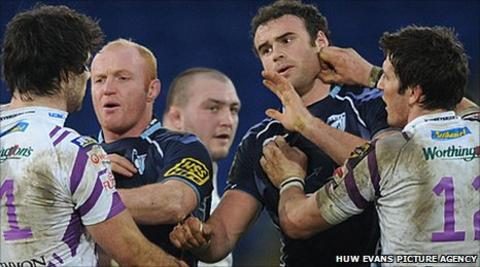 Jamie Roberts, James Hook, Martyn Williams and Mike Phillips tussle in December 2010