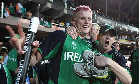 Kevin O'Brien and his brother Niall celebrate after the win over England