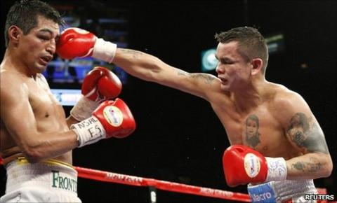 Erik Morales is hit by Marcos Maidana