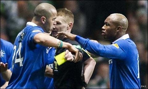 Madjid Bougherra and El Hadji Diouf surround referee Calum Murray