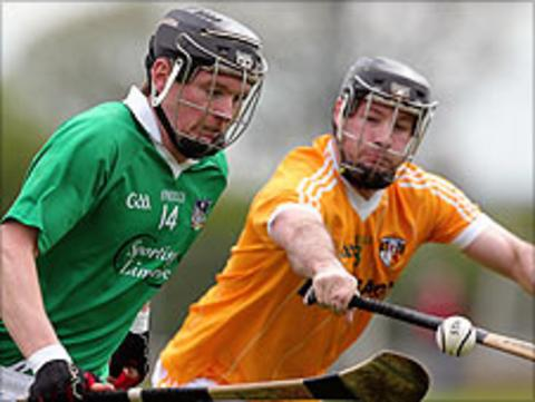 Limerick's Kevin Downes in action against Kieran McGourty of Antrim