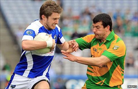 Laois forward MJ Tierney holds on to the ball as Donegal's Frank McGlynn moves in to challenge