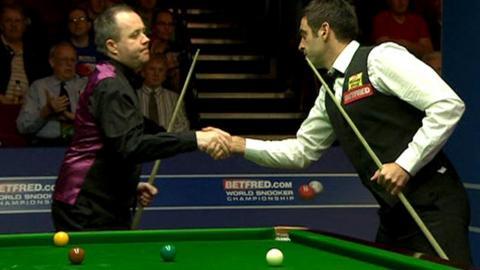 Ronnie O'Sullivan shakes the hand of opponent John Higgins