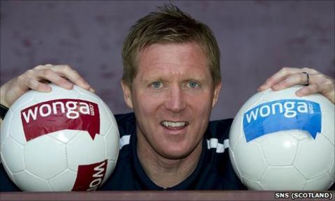 Hearts coach Gary Locke promotes the new sponsorship deal