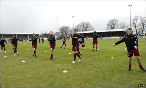 Motherwell players warm up at Stair Park