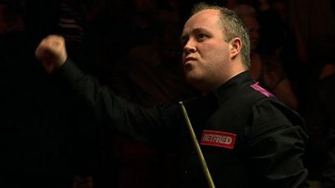 John Higgins celebrates his World Snooker semi-final win over Mark Williams