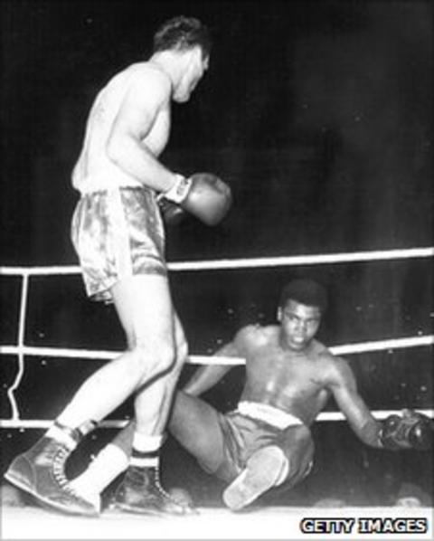 Henry Cooper (left) standing over the felled Cassius Clay