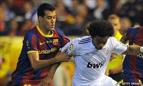 Sergio Busquets (l) and Marcelo (r)