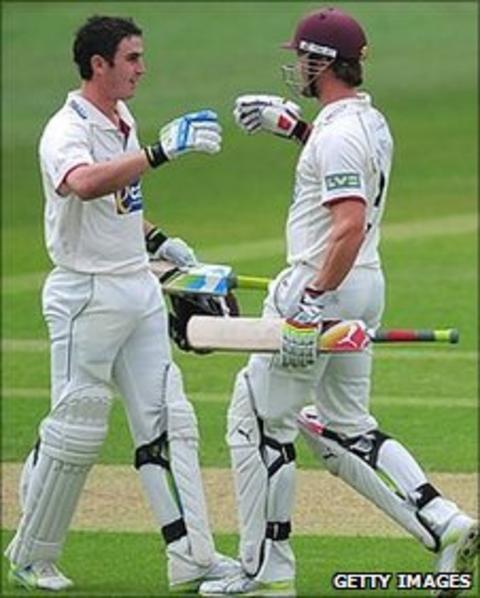 Somerset batsman Craig Kieswetter (l) is congratulated by Nick Compton