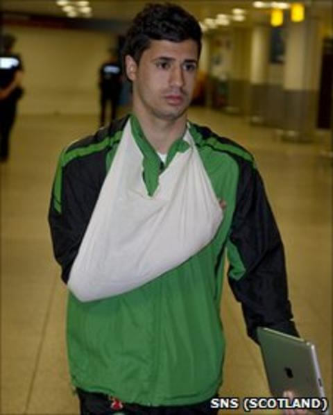Beram Kayal returns to Glasgow with his wrist in a sling