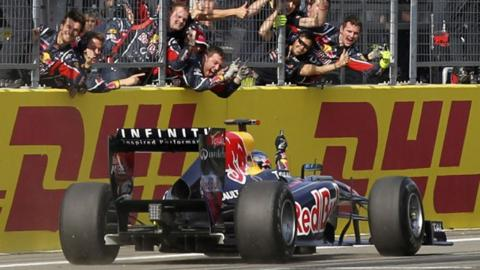 Red Bull mechanics toast Sebastian Vettel at the Turkish GP