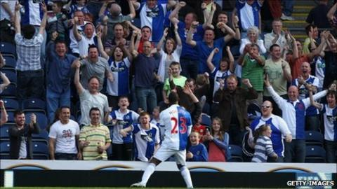 Blackburn supporters celebrate a goal against Birmingham on 9 April
