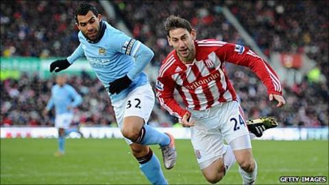 Manchester City's Carlos Tevez and Rory Delap of Stoke