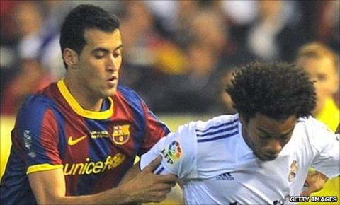 Sergio Busquets (left) and Marcelo (right)