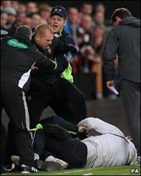 Neil Lennon is confronted by a fan at Tynecastle
