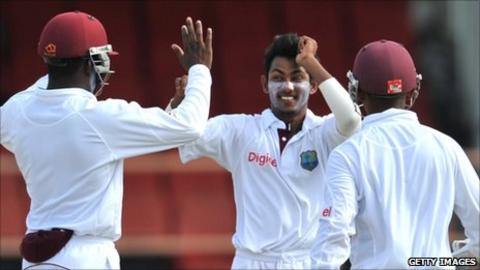 Devendra Bishoo celebrates taking a wicket