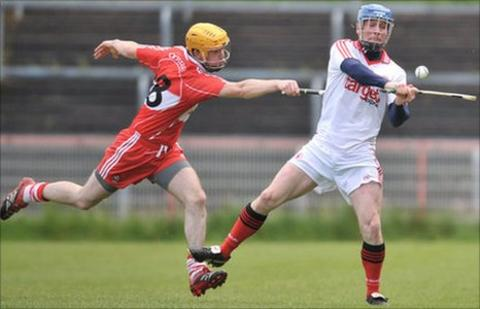 Derry's Martin Gorgan and Tyrone's Paddy Kelly