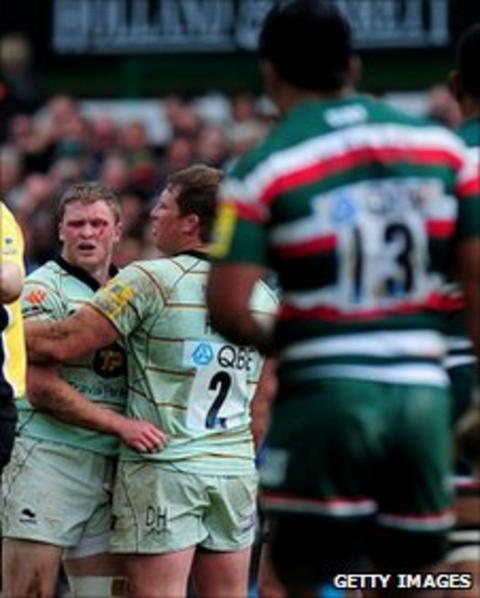 Chris Ashton reacts after being punched by Manu Tuilagi