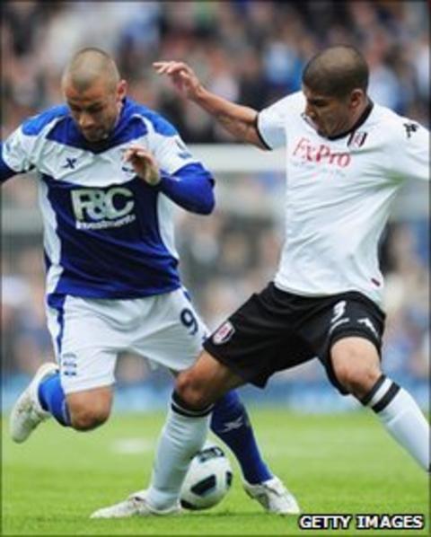 Fulham's Carlos Salcido tackling Birmingham's Kevin Phillips