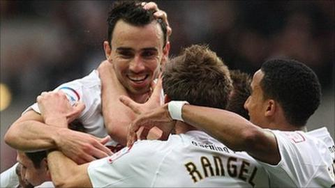 Leon Britton and team-mates celebrate his opening goal