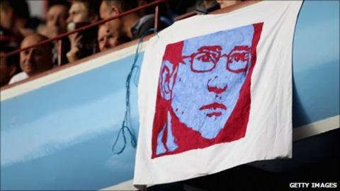 A flag depicting Martin O'Neill is draped over the stands at Villa Park