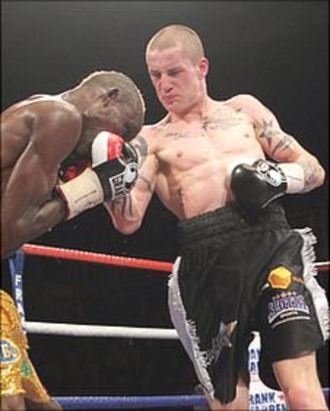 Ricky Burns in action against Joseph Laryea