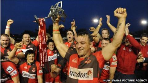 Llanelli captain Craig Hawkins lifts the Welsh Premiership title