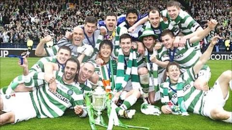 Celtic players celebrate winning the Scottish Cup